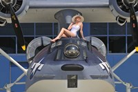 Retro pin-up girl posing with a World War II era PBY Catalina seaplane Fine Art Print