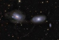 Gravitionaly distorted Galaxies NGC 3169 and NGC 3166 Fine Art Print
