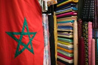 Moroccan Flag, The Souqs of Marrakech, Marrakech, Morocco by Walter Bibikow - various sizes, FulcrumGallery.com brand