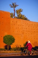 Veiled Woman Bicycling Below Red City Walls, Marrakech, Morocco by John & Lisa Merrill - various sizes - $40.49