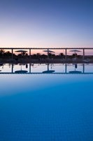 Tunisia, Jerid Area, Tozeur, Hotel El Mouradi Pool by Walter Bibikow - various sizes - $41.49