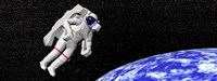 Astronaut floating in outer space above planet Earth Fine Art Print