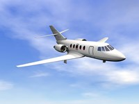 Private jet plane flying in cloudy blue sky by Elena Duvernay - various sizes