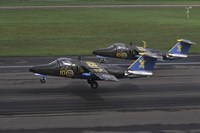 Saab 105 jet trainers on the strip by Daniel Karlsson - various sizes