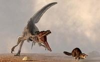 A velociraptor chasing a rat sized mammal Fine Art Print