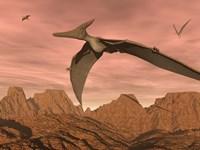 Three pteranodon dinosaurs flying above rocky landscape Fine Art Print