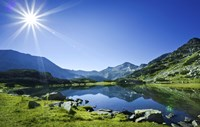 Muratov Lake against blue sky and bright sun in Pirin National Park, Bulgaria by Evgeny Kuklev - various sizes