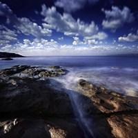 Rocky shore and tranquil sea, Portoscuso, Sardinia, Italy by Evgeny Kuklev - various sizes - $47.99