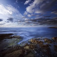 Tranquil lake and rocky shore against cloudy sky, Crete, Greece by Evgeny Kuklev - various sizes
