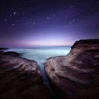 Two large rocks in a sea, against starry sky Fine Art Print