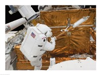 Astronaut works with the Hubble Space Telescope in the cargo bay of Atlantis Fine Art Print