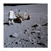 Astronaut walking near the lunar rover on the moon, Apollo 16 Fine Art Print