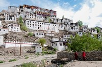 Monks standing in front of the Thiksey Monastery, Leh, Ledakh, India Fine Art Print