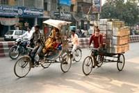 People and cargo move through streets via rickshaw, Varanasi, India Fine Art Print