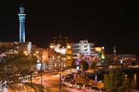 Oman, Muscat, Mutrah. Mutrah Corniche Buildings / Evening by Walter Bibikow - various sizes