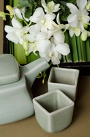 Traditional Thai tea pot and cups with orchid arrangement, Bangkok, Thailand by Cindy Miller Hopkins - various sizes