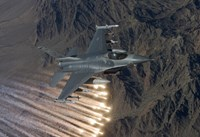 An F-16 Fighting Falcon Releases Flares Fine Art Print