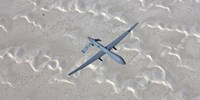 An MQ-1 Predator Flies over the White Sands National Monument, New Mexico by HIGH-G Productions - various sizes