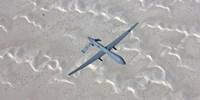 An MQ-1 Predator Flies over the White Sands National Monument, New Mexico Fine Art Print