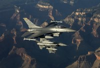 Two F-16's fly over the Grand Canyon, Arizona by HIGH-G Productions - various sizes