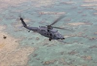 An HH-60G Pave Hawk Along the Coastline of Okinawa, Japan Fine Art Print