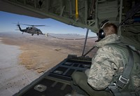 Loadmaster on an HC-130 Watches a HH-60G Pave Hawk Refuel by HIGH-G Productions - various sizes