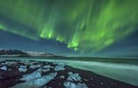 Aurora Borealis over the Ice Beach near Jokulsarlon, Iceland Framed Print