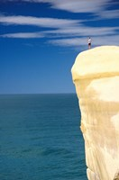 Person on Cliff Top, Tunnel Beach, Dunedin, New Zealand by David Wall - various sizes