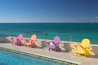 Colorful Pool Chairs at Compass Point Resort, Gambier, Bahamas, Caribbean by Walter Bibikow - various sizes