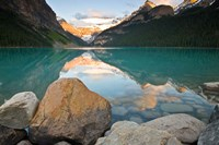 Rocky Mountains and boulders reflected in Lake Louise, Banff National Park, Alberta, Canada Fine Art Print