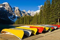 Moraine Lake and rental canoes stacked, Banff National Park, Alberta, Canada Fine Art Print