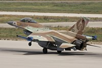 An F-16C Barak of the Israeli Air Force landing at Hatzor Air Force Base Fine Art Print