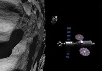 A Manned Maneuvering Vehicle descends toward the surface of a small asteroid Fine Art Print