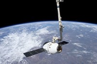 The SpaceX Dragon Cargo Craft in the Grasp of the Canadarm2 - various sizes - $47.49