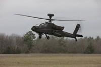 An AH-64 Apache Helicopter in Midair, Conroe, Texas Fine Art Print