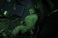 A Pilot Wears Night vision Goggles in the Cockpit of a CH-47 Chinook Helicopter Fine Art Print