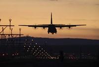 A C-130J Super Hercules Landing at Ramstein Air Base, Germany, at Dusk Fine Art Print
