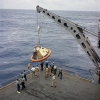 The Apollo Spacecraft Command Module is Recovered Aboard USS Bennington Fine Art Print