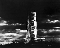 Searchlights Illuminate this Nighttime view of Apollo 17 Spacecraft on its Launchpad - various sizes