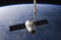 The SpaceX Dragon Cargo Craft Prior to being Released from the Canadarm2 Fine Art Print