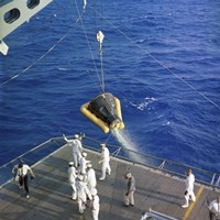 The Gemini-3 spacecraft is hoisted aboard the USS Intrepid during Recovery - various sizes