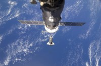 Space Shuttle Discovery approaches the International Space Station - various sizes