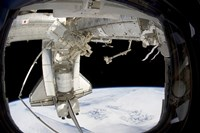 The docked Space Shuttle Discovery and Dextre - various sizes