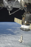 Space Shuttle Endeavour, a Soyuz Spacecraft, and the International Space Station - various sizes