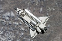 Aerial view of Space Shuttle Discovery over Earth as it approaches the International Space Station - various sizes