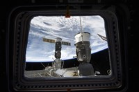 Two Russian Spacecraft Docked with the International Space Station, as seen from Space Shuttle Discovery's Flight Deck Window - various sizes