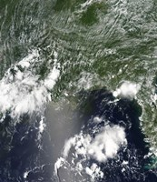 Satellite view of the Gulf of Mexico speckled and streaked with small clouds - various sizes