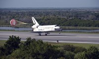 With Drag Chute Unfurled, Space Shuttle Discovery Lands on Runway 33 at Kennedy Space Center in Florida - various sizes