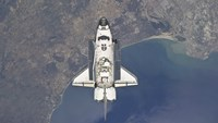 The Space Shuttle Atlanti Flying Above the Atlantic coast of Spain and the Gulf of Cadiz - various sizes
