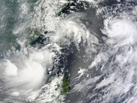 Three Strong Storms Churn in the Pacific Ocean Basin off the Asian coast - various sizes
